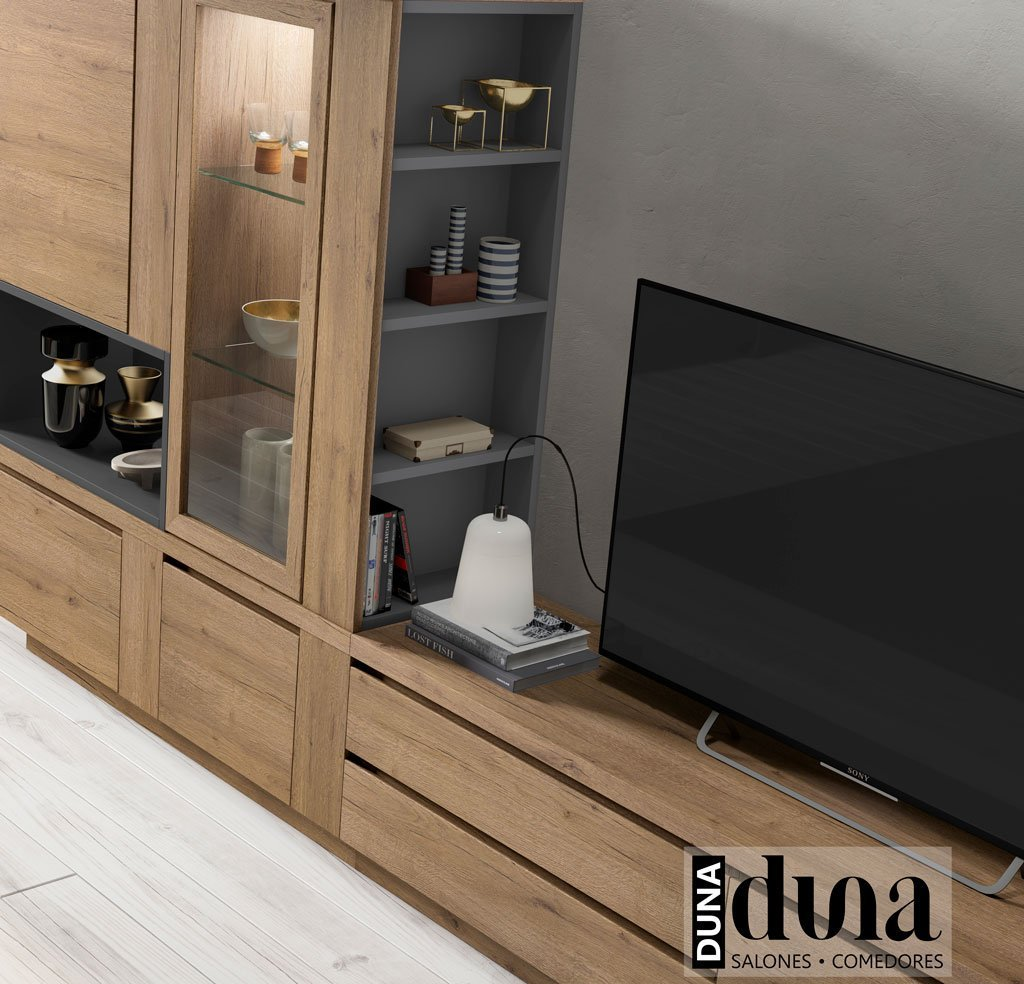 Detalle de la estantería oculta junto al mueble TV