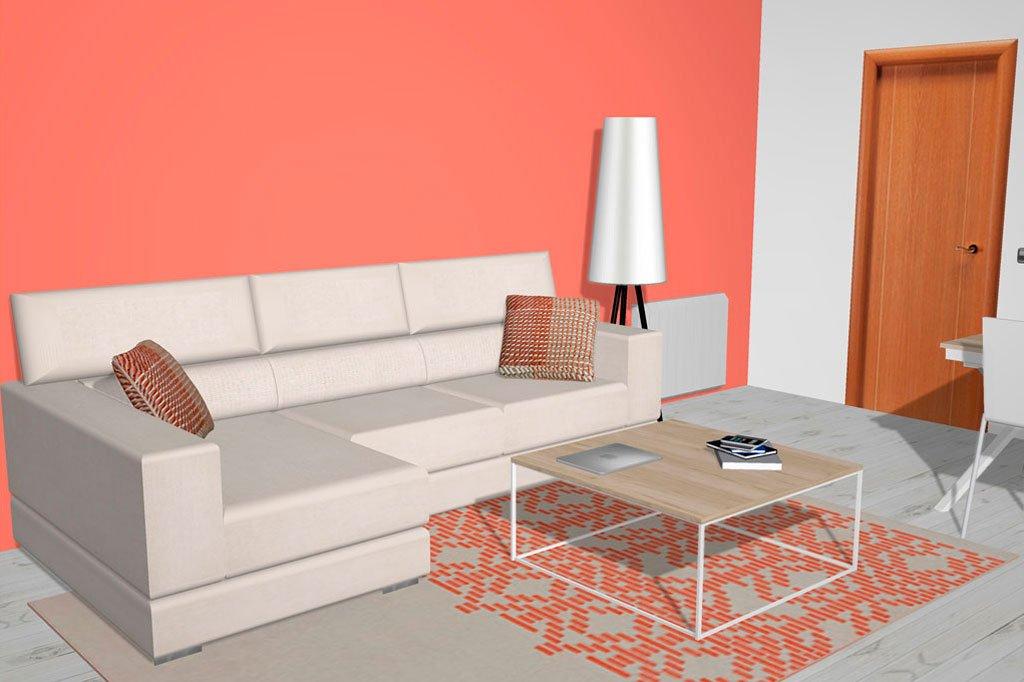 Mesa de centro con patas metálicas colocada frente el sofá